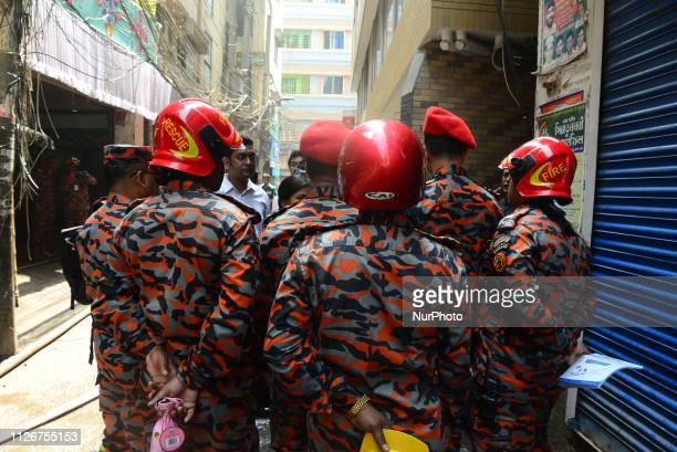 Bangladeshi rescue worker inspects a burnt building following a fire in Dhaka Bangladesh's capital city on February 22 2019 Funerals started on...