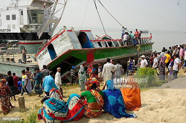 Bangladeshi rescue workers recover the capsied ferry at Paturia some 70kms east of Dhaka Local administration called off rescue operations as death...
