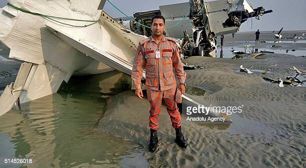 COX'S BAZAR BANGLADESH MARCH 09 A Bangladeshi rescuer poses as they inspect the wreckage of a cargo plane that crashed into the sea off near Cox's...