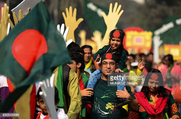 Bangladeshi residents take part in a parade to mark the country's 45th Victory Day in Dhaka on December 16 2016 Bangladesh led by the country's...