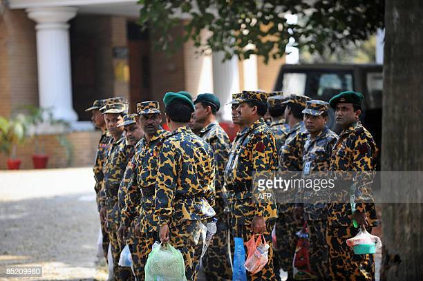 Bangladeshi Rifles soldiers fall in line near the entrance to the Bangladesh Rifles headquarters in Dhaka on March 3 2009 The Bangladesh military...