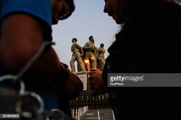 Bangladeshi secular activists take part in a torchlit protest against the killing of Avijit Roy in front of Raju Vashkorjo at TSC Dhaka Bangladesh on...