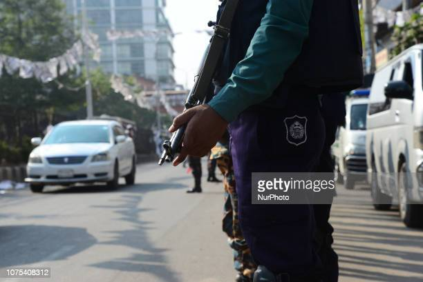 Bangladeshi Security forces stand guard in a street for the upcoming election in Dhaka Bangladesh on December 28 2018 Election security duties have...