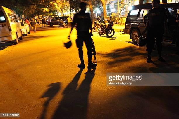 Bangladeshi security forces take security measures after armed attack held to a restaurant at a diplomatic area in Dhaka Bangladesh on July 1 2016
