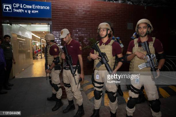 Bangladeshi security personel stands guird at VIP terminal in Hazrat Shahjalal International Airport Dhaka on March 16 2019 49 Muslims were killed in...