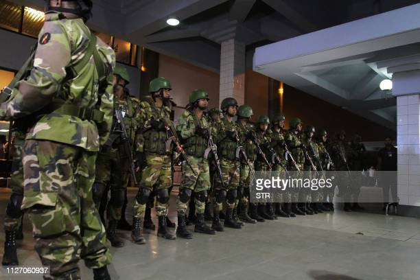 Bangladeshi security personnel stand guard at the Shah Amanat International Airport in Chittagong on February 24 after an emergency landing of the...
