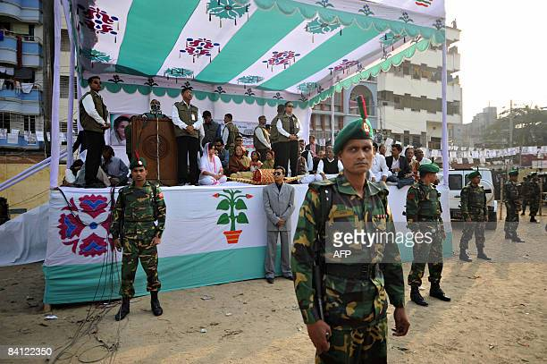 Bangladeshi security personnel stand guard during an Awami League party election campaign rally in Dhaka on December 25, 2008. Bangladesh will hold...
