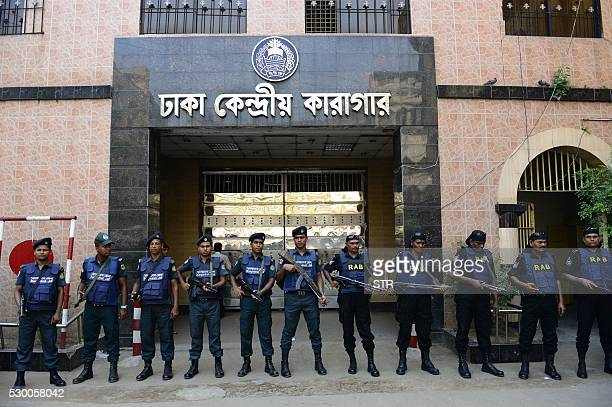 Bangladeshi security personnel stand guard outside a jail in Dhaka on May 10 where comvicted JamaateIslami leader Motiur Rahman Nizami is said to be...