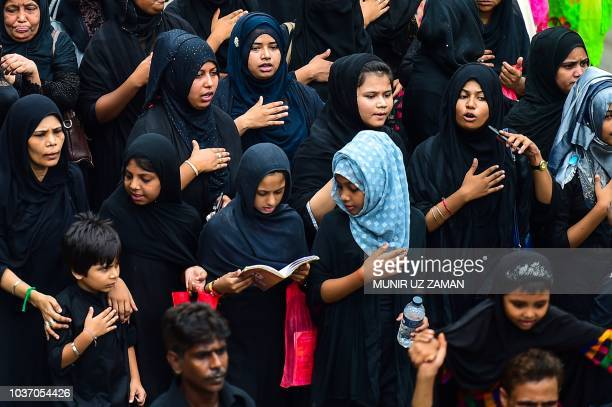 Bangladeshi Shiite Muslims perform a ritual as they take part in a religious procession during the Ashura mourning period in Dhaka on September 21...
