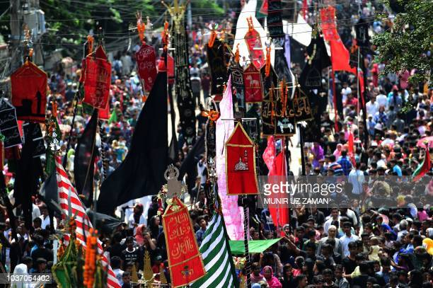 Bangladeshi Shiite Muslims take part in a religious procession during the Ashura mourning period in Dhaka on September 21 2018 The religious festival...