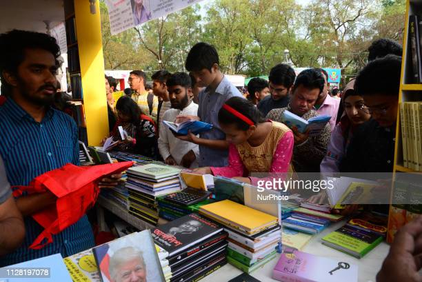 Bangladeshi shopper brows books at a stall in 'Omor Ekushey' book fair in Dhaka on February 28 2019 It is arranged each year by Bangla Academy and...
