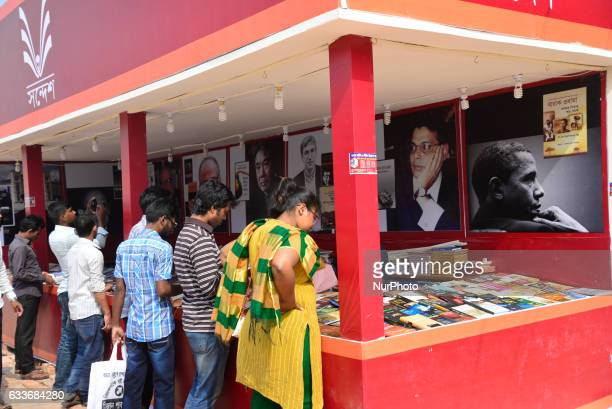 Bangladeshi shoppers brows books at a stall during the country's largest book fair in Dhaka on February 03 2017 Bangladesh's largest book fair began...