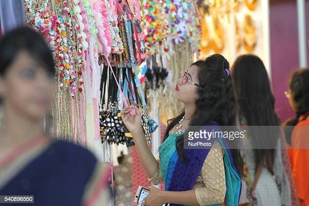 Bangladeshi shoppers visit at a market during the holy month of Ramadan ahead of Eid AlFitr celebrations in Dhaka on June 16 2016 Muslims around the...