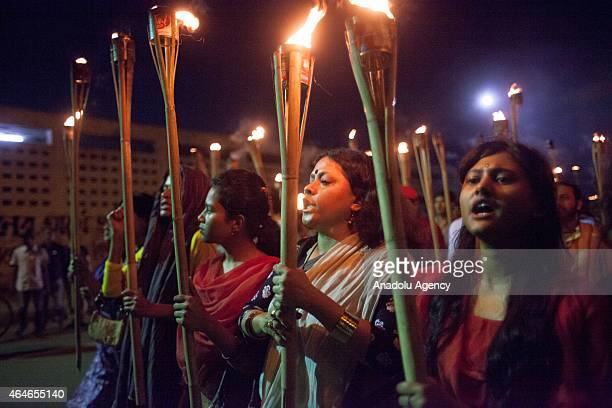 Bangladeshi social activists shout slogans as they participate in a torch rally held to protest against the killing of Avijit Roy in Dhaka Bangladesh...