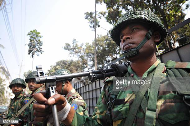 A Bangladeshi soldier holds his rifle as he and other troops gather outside the Bangladesh Rifles headquarters complex in Dhaka on February 25 2009...