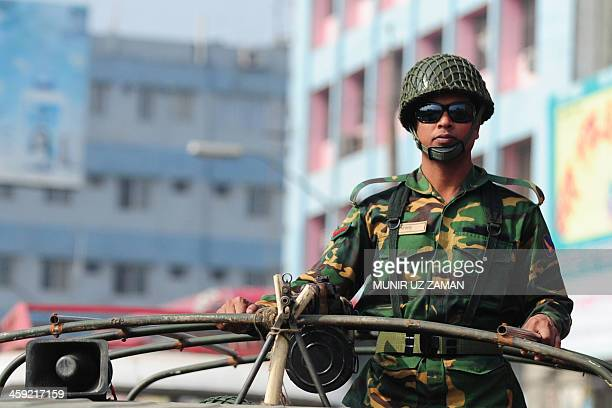 A Bangladeshi soldier looks on from a patrolling truck during an ongoing blockade organised by the main opposition Bangladesh Nationalist Party and...