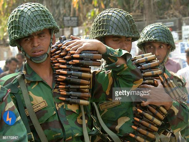 Bangladeshi soldiers carry machine gun shells as they gather outside the Bangladesh Rifles headquarters complex in Dhaka on February 25 2009...