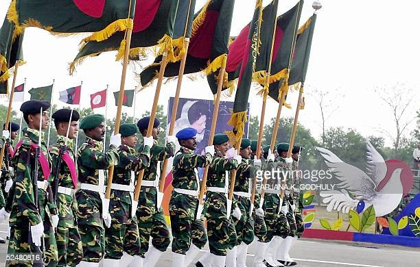 Bangladeshi soldiers hold national flags as they parade during the Independence Day celebrations in Dhaka 26 March 2005 Bangladesh became independent...