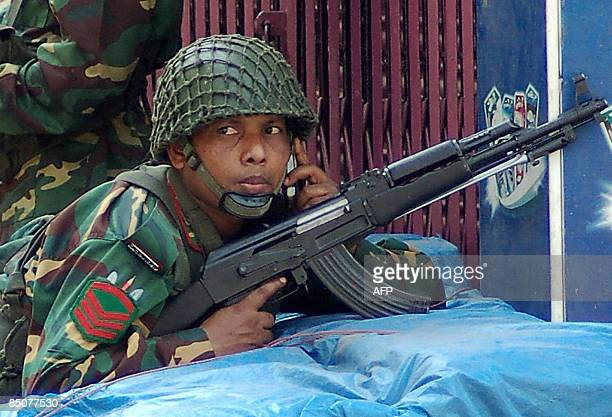Bangladeshi soldiers take position with mortars and automatic weapons outside the Bangladesh Rifles headquarters complex in Dhaka on February 25 2009...