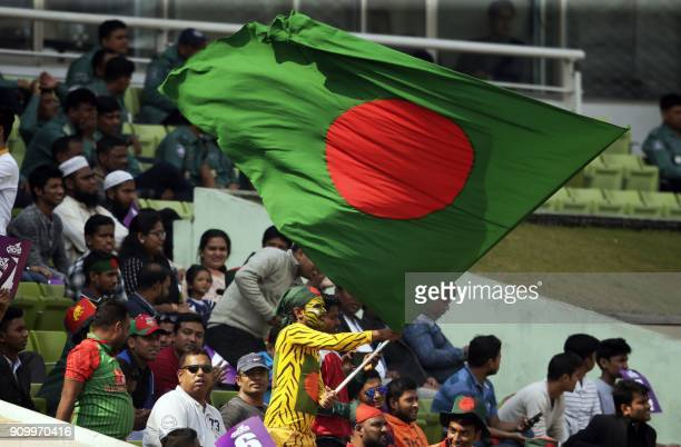 A Bangladeshi spectator weaves national flag during the sixth One Day International match in the TriNations series between Bangladesh and Sri Lanka...