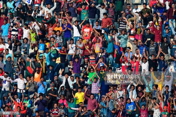 Bangladeshi spectators cheer during the third one day international cricket match in the TriNations Series between Bangladesh and Sri Lanka at the...