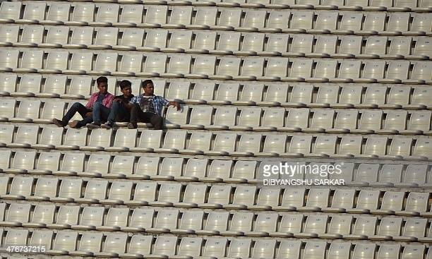 Bangladeshi spectators watch the match during the ninth match of the Asia Cup one-day cricket tournament between India and Afghanistan at the...