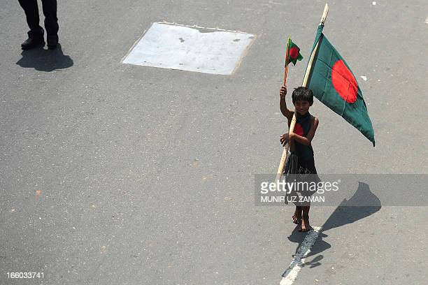 A Bangladeshi street child marches with the national flag as protestors hold an antistrike rally during a nation wide strike called by Islamists in...