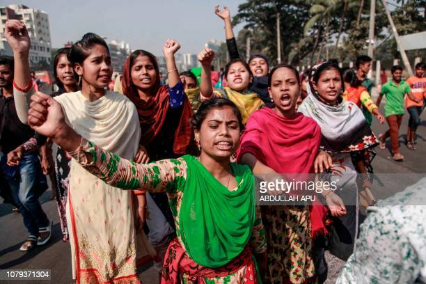 Bangladeshi striking garments workers march in the streets of Dhaka on January 8 2019 during a third day of demonstration to demand wage hikes...