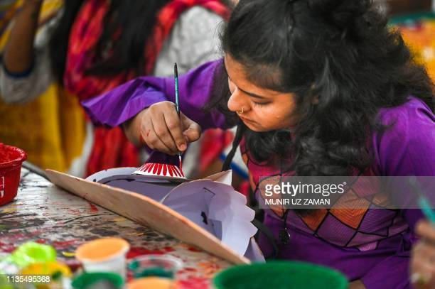 A Bangladeshi student of Dhaka University Art Institute paints a mask to sell as a part of Bengali New Year preparations in Dhaka on April 7 2019 The...