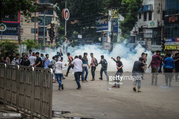 A Bangladeshi student prepares to throw back a tear gas shell fired by the police during a student protest in Dhaka on August 5 following the deaths...