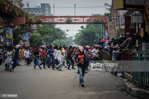 Bangladeshi students during clashes with the police during a student protest in Dhaka on August 5 following the deaths of two college students in a...