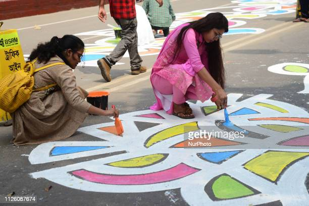 Bangladeshi students of Dhaka University paints in street in front of Central Shaheed Minar language movement martyrs monument ahead of International...