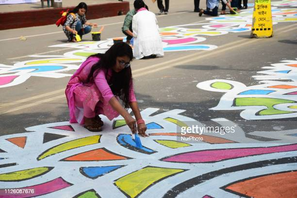 Bangladeshi students of Dhaka University paints in street in front of Central Shaheed Minar, language movement martyrs monument, ahead of...