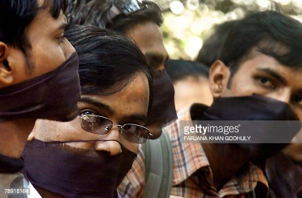Bangladeshi students of Dhaka's main university gag their mouths with black ribbon during a protest at a campus in Dhaka 13 January 2008 Hundreds of...
