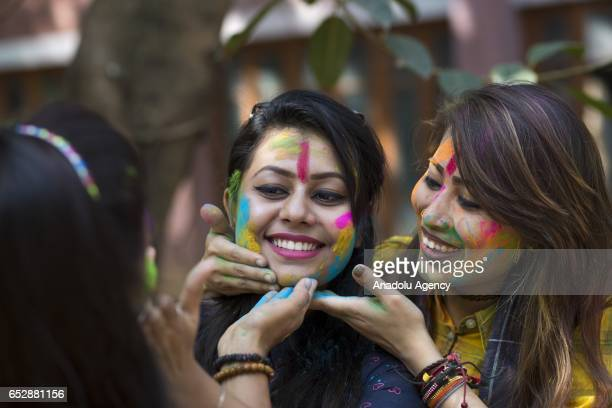 Bangladeshi students play with colored powder during Holi celebrations at the Fine Arts Institute of Dhaka University in Dhaka Bangladesh on March 13...