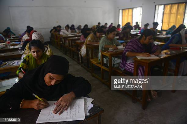 Bangladeshi students sit for their third year final examination at The National University of Bangladesh in Dhaka on July 3 during an ongoing...