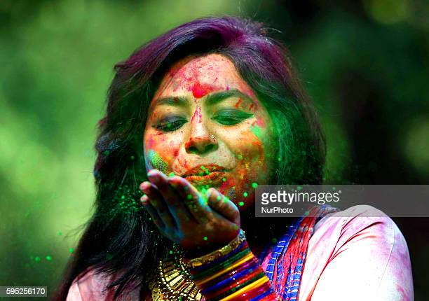 Bangladeshi students throw coloured powder during Holi celebrations at the Fine Arts Institute of Dhaka University on March 23 2016 The Holi festival...