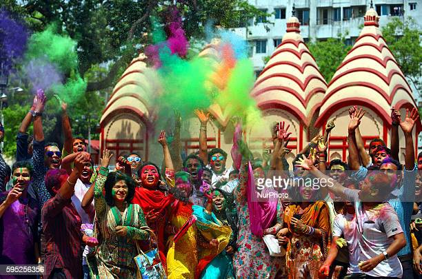 Bangladeshi students throw coloured powder during Holi celebrations at the Fine Arts Institute of Dhakeshwari on March 23 2016 The Holi festival is...