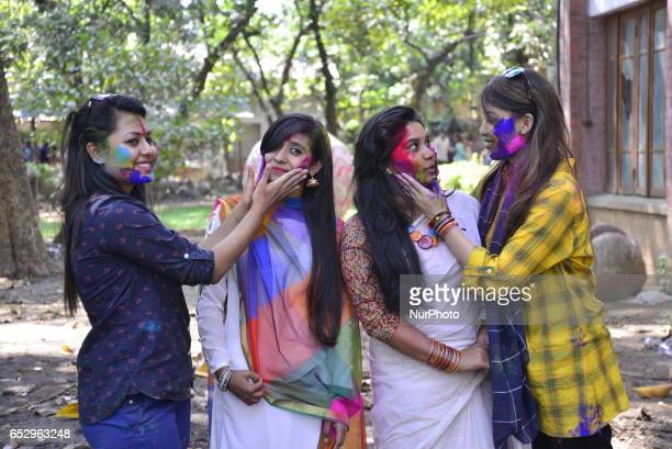 Bangladeshi students throw coloured powder during Holi celebrations at the Fine Arts Institute of Dhaka University on March 13 2017 The Holi festival...