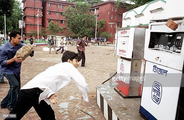 Bangladeshi students throw rocks at petrol pumps in front of Dhaka University Dhaka 24 September 2003 Hundreds of students from the university stoned...