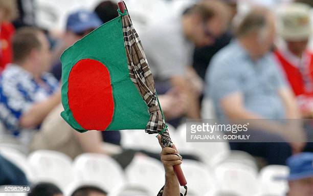 Bangladeshi supporter waves a Bangladeshi flag during the first day of the first Test between England and Bangladesh at Lord's in London 26 May 2005...