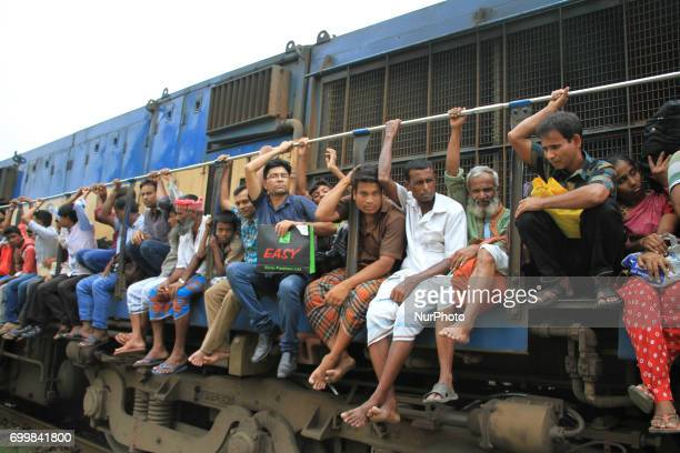 Bangladeshi travelers are ride on an overcrowded to go home to celebrate EidulFitr holyday with their family in Dhaka Bangladesh on June 22 2017