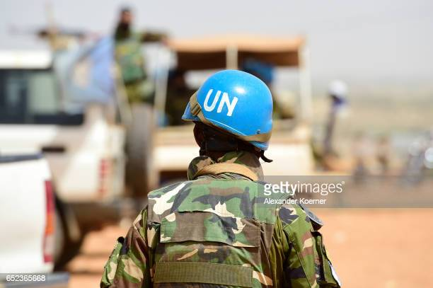 Bangladeshi United Nations soldier walks by a car during the weekly cattle market on March 7 2017 in Gao Mali Each week locals and Touareg nomads...
