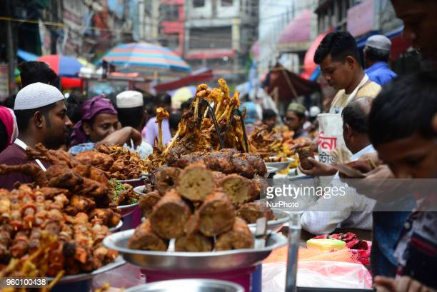 Bangladeshi vendor sells Iftar's items at chawkbazar in the capital Dhaka Bangladesh on the Second day of Muslim fasting month Ramadan on May 19 2018...