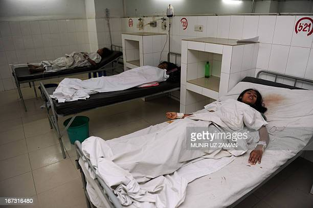 Bangladeshi victims are treated in a hospital after a building collapse in Savar, on the outskirts of Dhaka, on April 24, 2013. An eight-storey...
