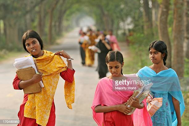 Bangladeshi village girls come back form school at Jessore on February 27 2007 Girls education is compulsory and free in Bangladesh