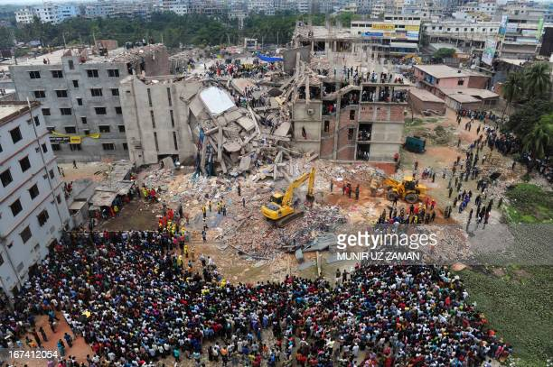 Bangladeshi volunteers and rescue workers are pictured at the scene after an eightstorey building collapsed in Savar on the outskirts of Dhaka on...