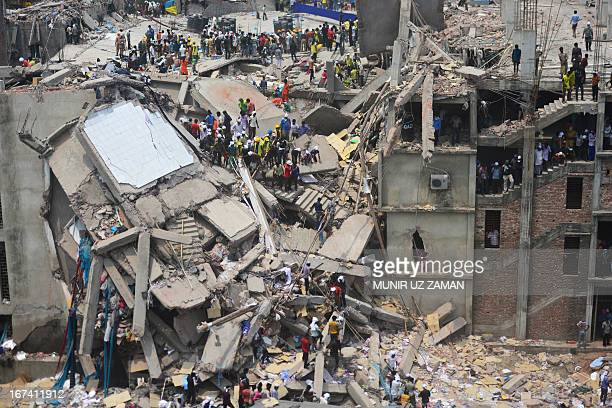 Bangladeshi volunteers and rescue workers assist in rescue operations after an eightstorey building collapsed in Savar on the outskirts of Dhaka on...
