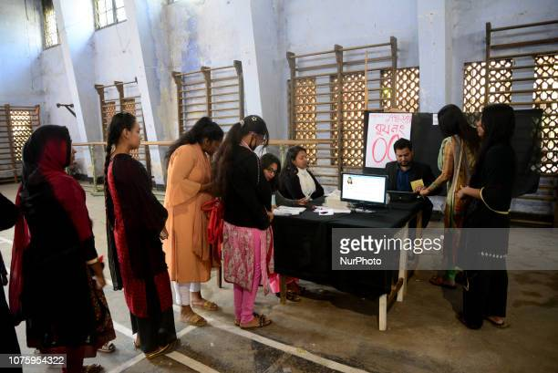 Bangladeshi voters cast their vote by electoral Voting Machine at a polling station located in a gymnasium in Dhaka Bangladesh on December 30 2018