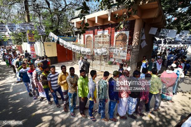 Bangladeshi voters wait in line outside a polling station in Dhaka on December 30 2018 Bangladesh headed to the polls on December 30 following a...
